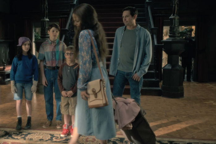 haunting of hill house ghost in background