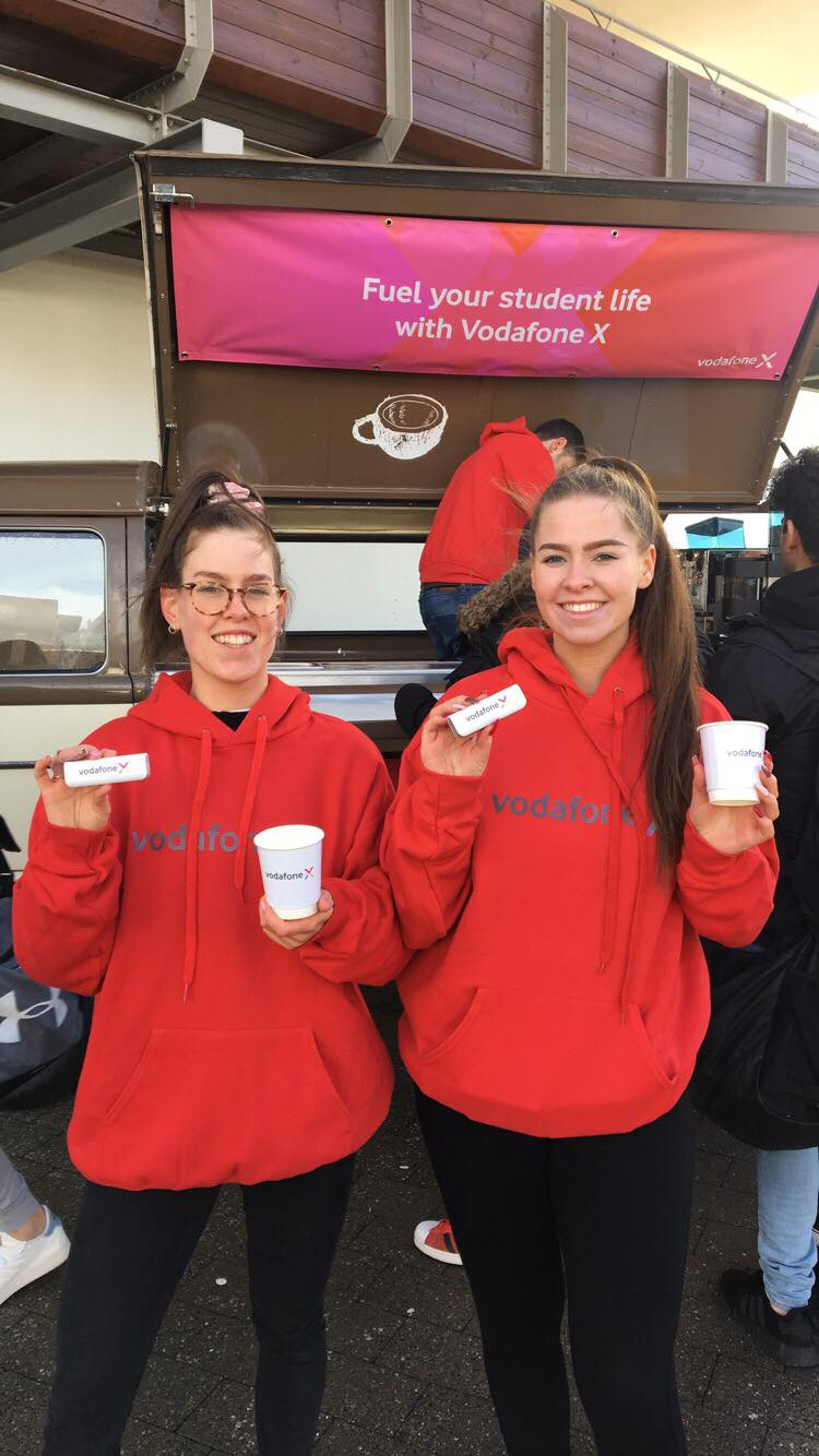 Students in TU Dublin Blanchardstown Campus enjoying free coffee and power banks thanks to Vodafone X